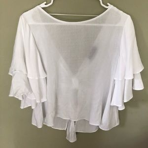 white flutter sleeve blouse